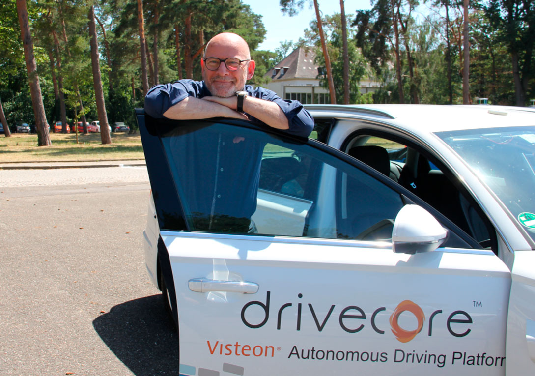 Transport Minister Winfried Hermann test drives a Visteon autonomous vehicle